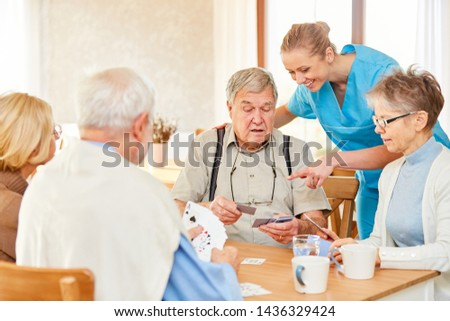 Nursing home and group seniors playing cards in nursing home or nursing home