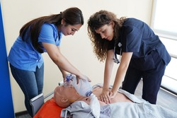 Nursing students are learning how to rescue the patients in emergency. CPR training with CPR doll.