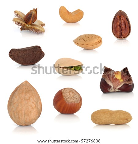Nut collection  isolated over white background with reflection.
