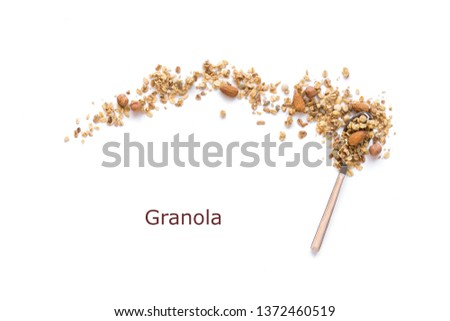 Nut Granola on spoon isolated on white background, copy space. Healthy snack or breakfast concept - homemade granola with grains and nuts. Stockfoto ©