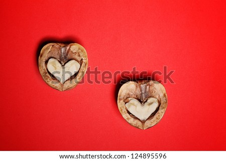 nut have broken in half, the two halves of the heart on  background, a card for Valentine's Day