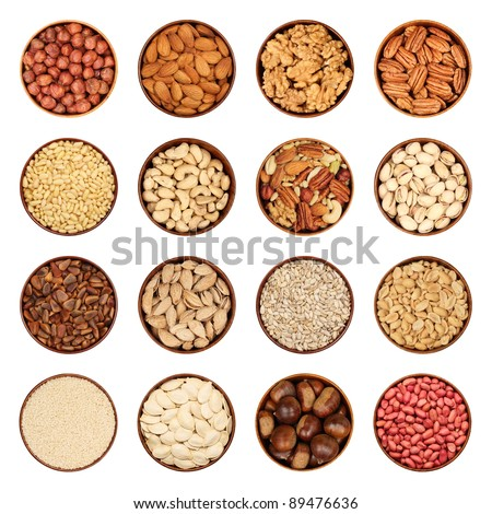 Nut mix - hazelnuts, peeled almonds, walnuts, pecans, pine nuts, cashews, nut mix, pistachios, seeds, pumpkin seeds, chestnuts, peanuts, sesame seeds in wooden bowls, isolated, background white.