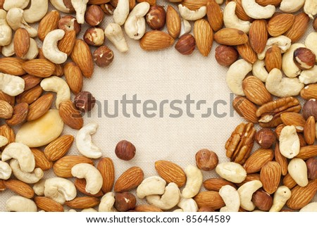 nut mix (walnut, almond, brazilian, hazelnut, cashew) on canvas with a copy space
