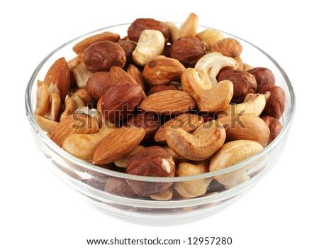 Nut mix with hazelnut and almond on white - stock photo