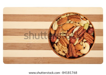 Nut mixture in a bowl - almonds, walnuts, pecans, pine nuts, pistachios, cashews