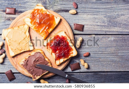 nut nougat cream with chocolate , strawberry, apricot jam and peanut butter sandwich . ストックフォト ©