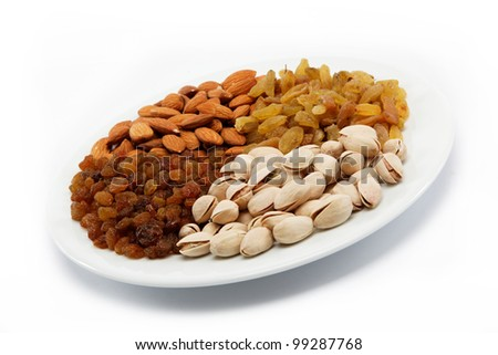 Nut-raisin mix. Almond and pistachio nuts and raisins. - stock photo