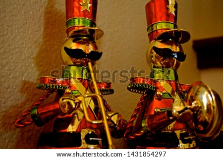 Nutcrackers made of metal and wood, either hanging as an ornament in the Christmas tree or just standing alone. Favorite Christmas soldiers. #1431854297