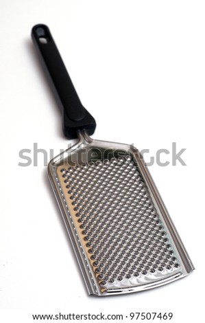 Nutmeg grater of stainless steel in front of a white background