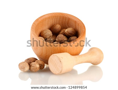 nutmeg in wooden mortar isolated on  white