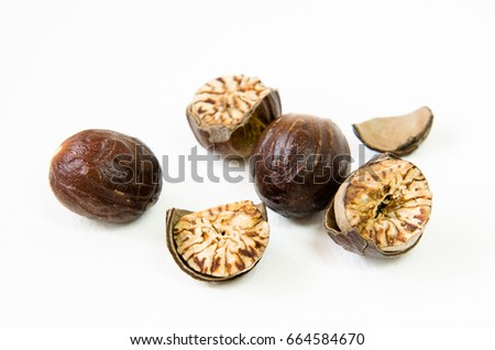 nutmeg isolated on white background  #664584670