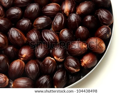 Nutmeg seeds in a  plate