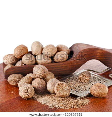nutmeg with steel hand grater isolated on white background