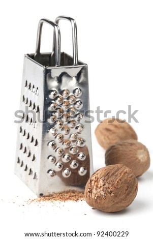 Nutmegs and grater on white background. Shallow dof