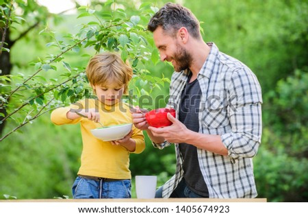 Nutrition kids and adults. Organic nutrition. Healthy nutrition concept. Nutrition habits. Family enjoy homemade meal. Personal example. Father teach son eat natural food. Little boy and dad eat. #1405674923