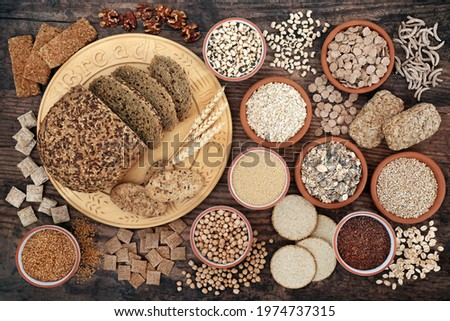 Nutritional health food with high fibre content with grain, legumes, seeds, nuts,  cereal foods also high in antioxidants, minerals, vitamins  smart carbs. Health care concept on rustic wood.   Stock photo ©