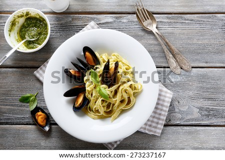 Nutritional pasta with seafood, top view #273237167