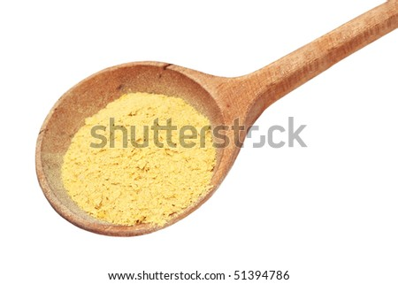 Nutritional yeast flakes in a wooden spoon isolated on white with clipping path included.