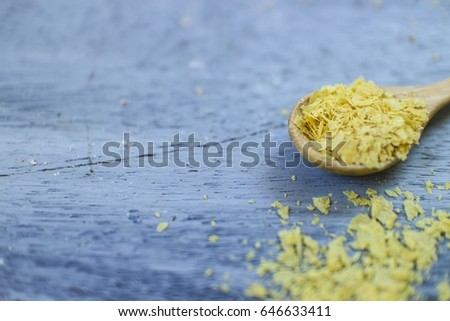 Nutritional Yeast on Wooden Background #646633411