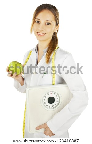 Nutritionist holding a green apple and weight scale. Healthy eating and lifestyle concept.
