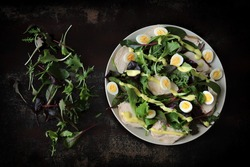 Nutritious salad with chicken breast and quail eggs. Keto diet salad.