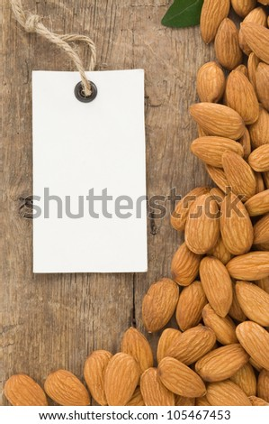 nuts almond and tag price label on wood background