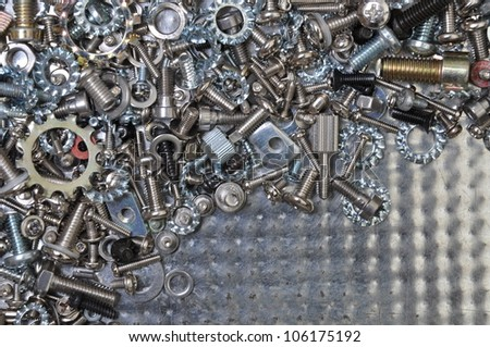 Nuts and bolt on chrome plated sheet - stock photo