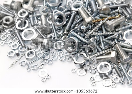 Nuts and bolts on plain background #105563672