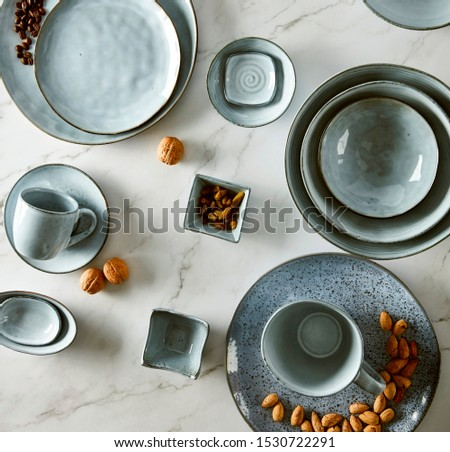 Nuts and coffee beans in blue ceramic ware #1530722291