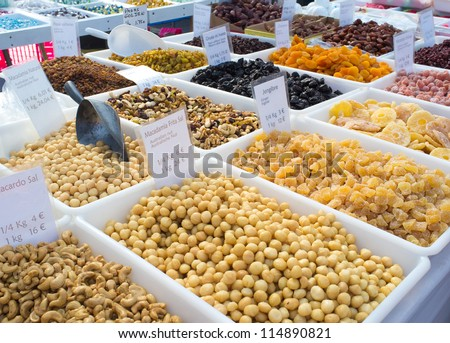 Nuts and dried fruit on display on a street market stall