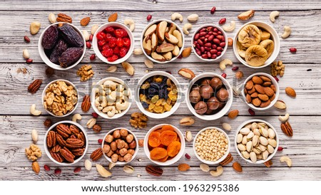 Nuts and dried fruits assortment, top view. Сток-фото ©