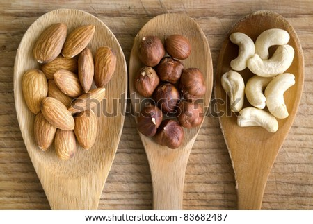 nuts in spoon - stock photo