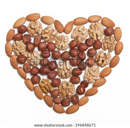 Nuts, laid out in the shape of a heart on a white background