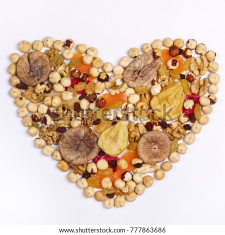 Nuts Mix and Dried Fruits in Heart Shape on White Background Top View Square #777863686