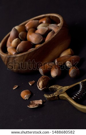 nuts plate and nuts pick. cracked nuts and nuts in bowl.