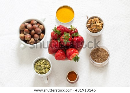 Nuts, spices and strawberries on the white background #431913145