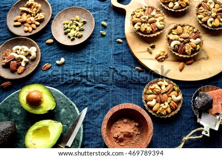 Nuts tarts with avocado on the cloth of deep blue. #469789394