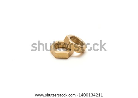 Nuts two nuts on a white background. Brass nuts. Golden nuts.