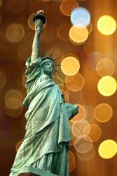 NY Statue of Liberty against holidays flash circle