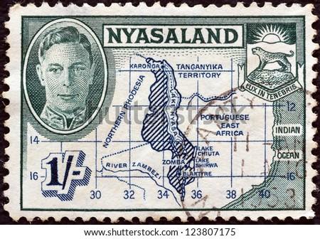 NYASALAND - CIRCA 1945: A stamp printed in Nyasaland shows Map of Nyasaland and King George VI, circa 1945.