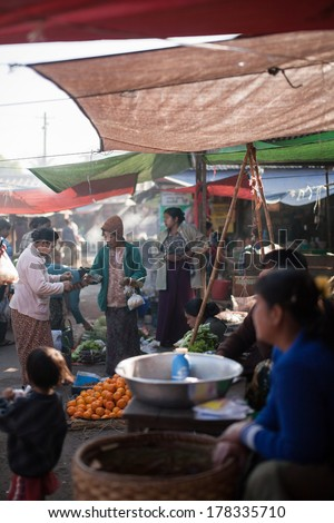 NYAUNG SHWE, MYANMAR - FEBRUARY 15: Mingalar Market, is a big market selling rice, fish, vegetables, flower, clothes, souvenirs on Feb 15, 2014 in Nyaung Shwe, Myanmar.