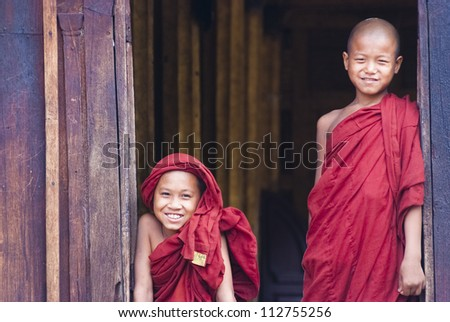 NYAUNG SHWE, MYANMAR  MAY 6: Unidentified novices at Shwe Yan Phe Monastery on May 6, 2012 in Nyaung Shwe, Myanmar.  Boys at 8-20 years old have to enter the Buddhist Order as a novice.