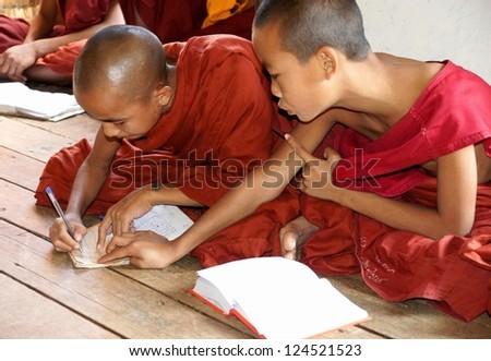 NYAUNG SHWE, MYANMAR NOVEMBER 22: Unidentified novice at Shwe Yan Phe Monastery on Nov. 22 , 2011 in Nyaung Shwe, Myanmar.Young boys  have to enter the Buddhist Order as a novice.