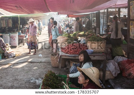 NYAUNGSHWE, MYANMAR - FEBRUARY 15: Mingalar Market, is a big market selling rice, fish, vegetables, flower, clothes, souvenirs on Feb 15, 2014 in Nyaungshwe, Myanmar.
