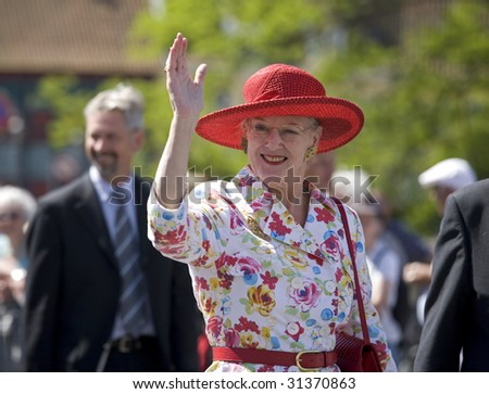 NYBORG, DENMARK - JUNE 2 :  H M Queen Margrethe the 2nd of Denmark waves to the crowds during her official visit  June 2, 2009 in Nyborg.