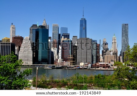 NYC - May 11,2014:  View of lower Manhattan skyscrapers in the financial district, the Southport Seaport, and One World Trade Center Tower seen from the Promenade in Brooklyn Heights #192143849