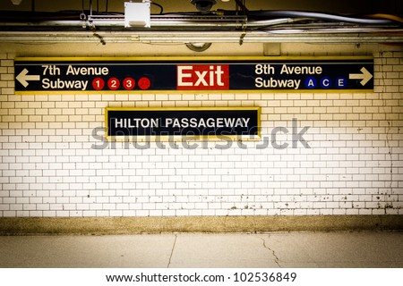 NYC Penn Station subway directional sign on tile wall #102536849