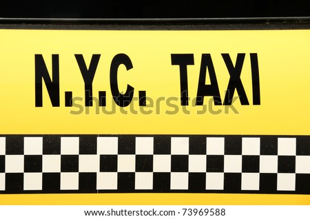 NYC Taxi sign on yellow.