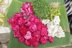 Nyekar is prayer for Ancestor, Javanese Ritual. Usually this ritual contains a bunch of special species flowers like roses, kantil, jasmine and cananga.