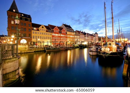 Nyhavn is a colourful 17th century waterfront, canal and popular entertainment district in Copenhagen, Denmark.